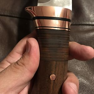walnut and copper handle detail
